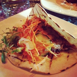 Origin Chinois duck in a flour tortilla with cucumber, hoisin, sriracha and sour cream